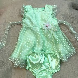 Green formal toddler dress with polka dots